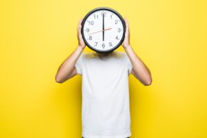 A man holding a clock.